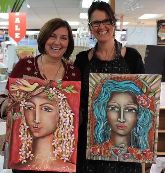 Kerry and Denise with collaborative teaching paintings
